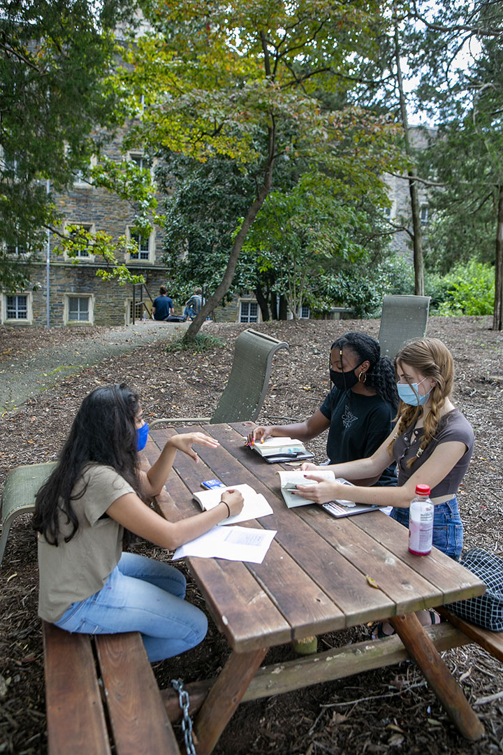 Students in Taylor Black's literature course have discussion time outside their class, while masked, at the Social Sciences Building.