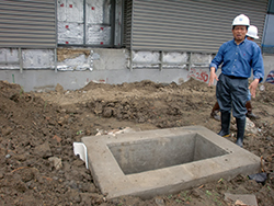 Rey Azares, Duke's director of information technology for DKU, inspects the manholes and conduits made for DKU's fiber-optic network.