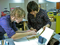 Erin Hammeke, left, a Duke Libraries special collections conservator, meets with Shilin Zhang, right, deputy director of the archives at Renmin University of China, in the Duke Libraries Conservation Lab in Durham.