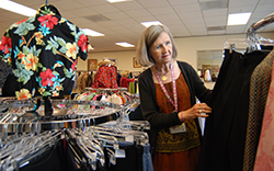 Eva Hoke, data manager for the Cancer Center Statistical Center, visits the Nearly New Shoppe at least once a week to see what new treasures have arrived.
