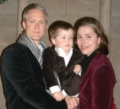 Alex Bettger, 3, with his parents. Mark and Janet Prvu Bettger. Photo courtesy of the Bettger family.