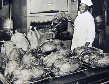 In this undated photo, presumably from late 1951, a Duke Dining employee shows a collection of turkeys roasted as part of a study for the National Turkey Federation. Photo courtesy of University Archives.
