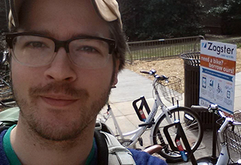 Graduate student Gabriel Yapuncich poses for a selfie by a rack of bikes with Duke's bike-share program, Zagster, as part of a social media activity for the Unpark Yourself Challenge. Photo courtesy of Gabriel Yapuncich.