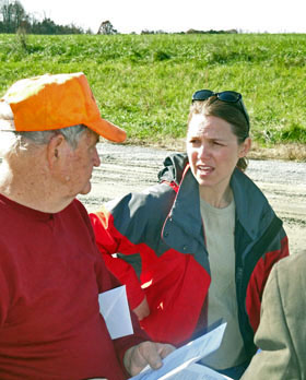 Hog farmer Loyd Bryant confers with Duke's Tatjana Vujic during a November 2009 site visit.