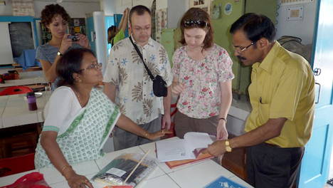 North Carolina teachers who traveled to India in April visited Kendriya Vidyalaya in Kolkata, part of India's largest public school system. Principal M. Mariappan, left, and teacher A. Roy Choudhury, right, reviewed materials with Polk County teacher Sergey Zalevskiy and Rutherford County teacher Jennifer Keeter.
