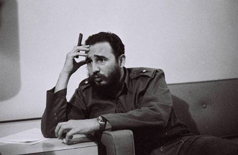 Fidel Castro is photographed in a journalist's room in the Habana Libre Hotel, writing to the French ambassador.