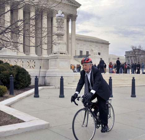 Walter Dellinger arrives at the Supreme Court in Washington, D.C, on his bicycle to argue District of Columbia v. Heller.
