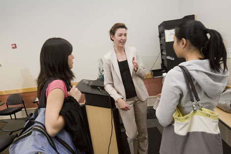 Johnson Teaching Award-winner Laura Edwards speaks with student Sanette Tanaka, right, and Lucy Li after class.
