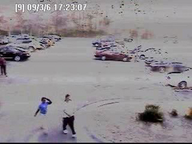 Two of the suspects caught on video walking from the parking lot.
