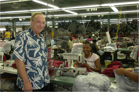 Duke Stores director Jim Wilkerson visits the Dominican Republic factory.
