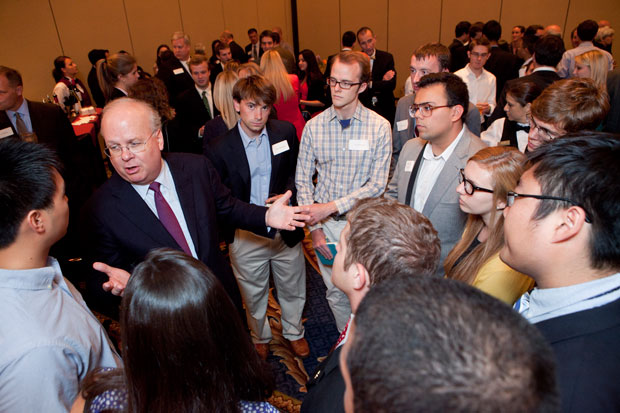 Karl Rove talks with students prior to the debate