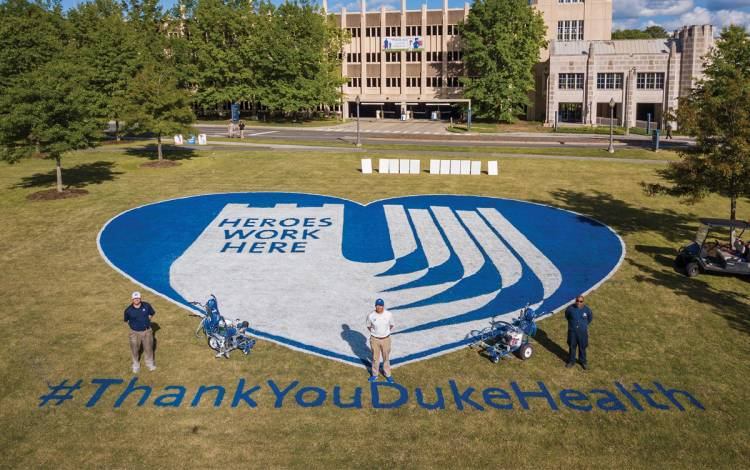 Duke University Facilities Landscape Services Athletics team created an appreciation message in April on the Duke Medicine Circle Lawn. Photo by Bill Snead, University Communications.