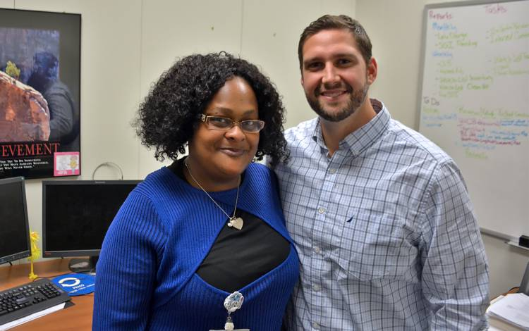Ina Shippy, left, and Joshua Roberts, right, have worked together at PRMO for about six months at Duke's Patient Revenue Management Organization. Photos by Jonathan Black.