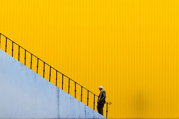 graphic of person walking large staircase
