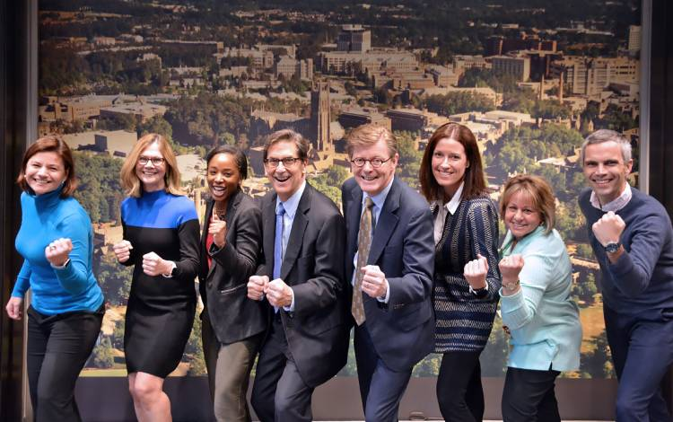 Left to right: Laura Brown, Terry Chambliss, Asyia Mitchell, Richard Riddell, President Vincent E. Price, Maggie Epps, Stephanie Mazzerina and Lawrence Kluttz make up