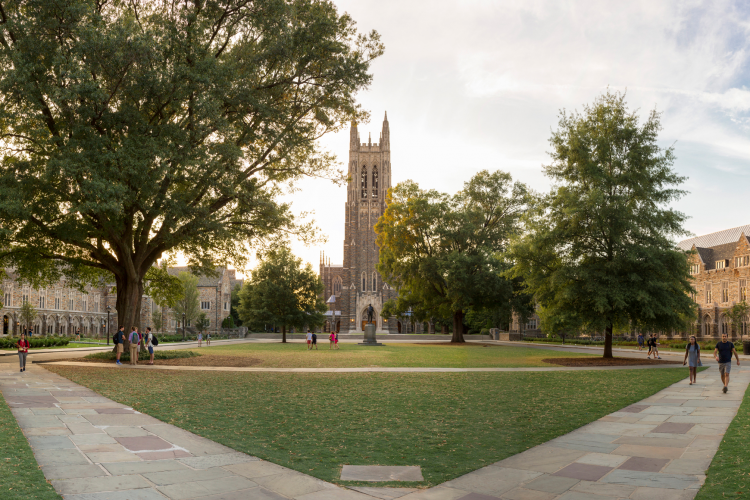Students and others walk on Abele quad, named after the Black architect who designed much of West Campus.