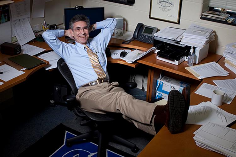 Robert Lefkowitz relaxing in his office