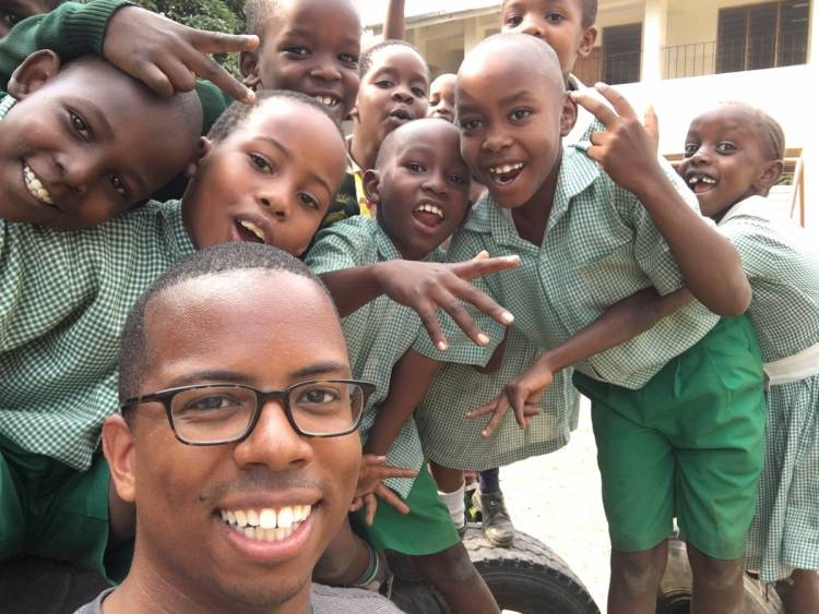 Matthew Turrentine, seen here with children during his mission trip last year, submitted this picture.