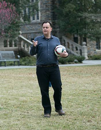 Laurent Dubois takes the Soccer Politics class outdoors for a lesson on the game. Photo by Julie Schoonmaker