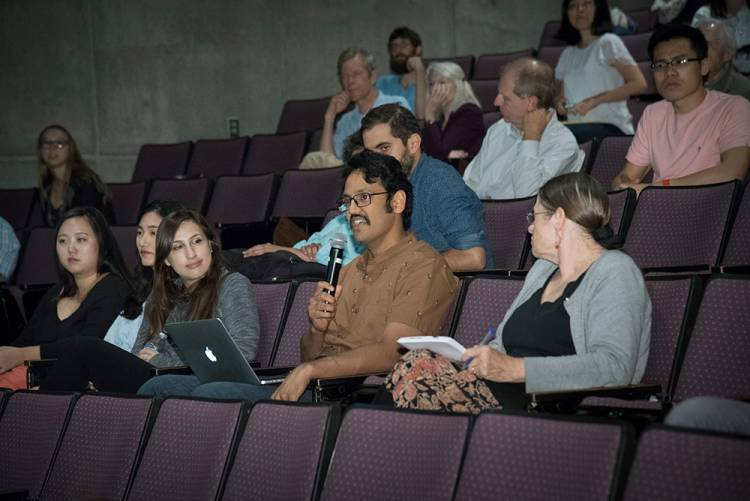 Audience members ask questions of Michael Tomasello following his presentation. Photo by Les Todd
