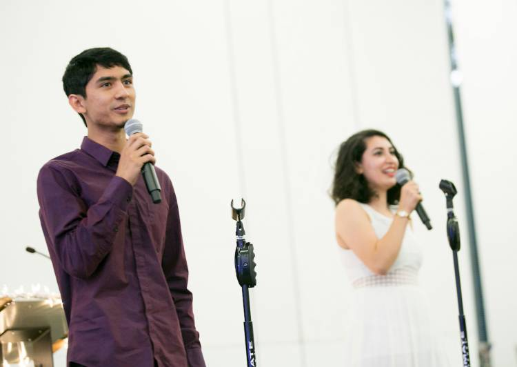 Amir Azhar, left, and Parmida Mostafavi, right, both members of the Duke Muslim Students Association, welcome guests to the annual Eid Banquet on Saturday evening at Penn Pavilion.