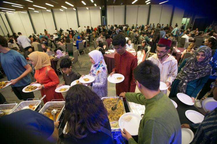 Guests enjoy the food at the Eid banquet.