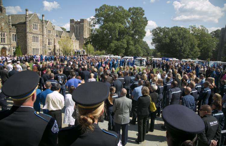 Duke colleagues and first responders gather outside Duke Chapel.