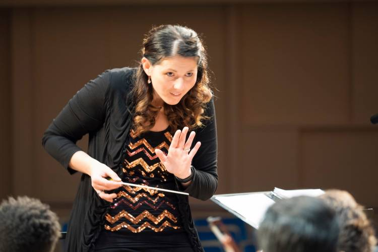 Verena Mosenblichler-Bryant conducts the Durham Medical Orchestra. Photo by Bill Snead/Duke Photography