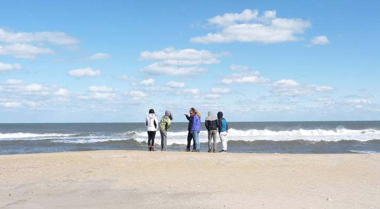 Alex Glass and students explore issues of climate change during a visit to North Carolina's Outer Banks. Photo by Susan Kauffman
