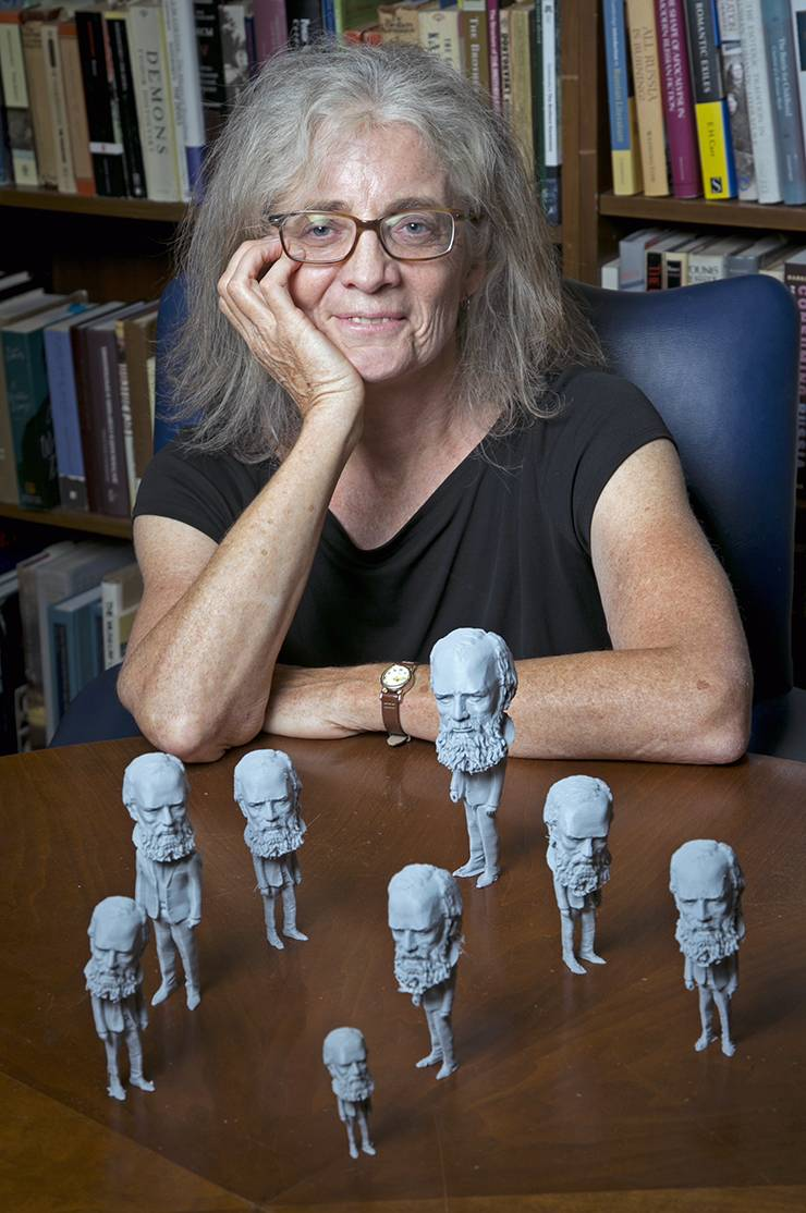 Carol Apollonio sits with the Fyodor Dostoevsky figures she and her students printed with help from the Co-Lab Studio.