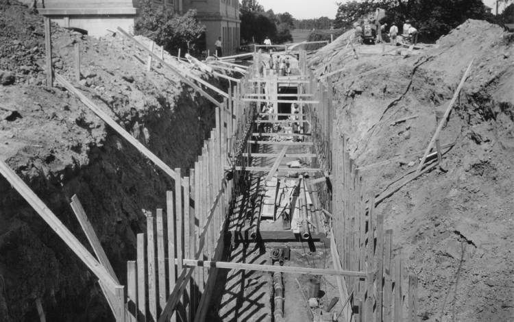 Crews install drain tiles and gutters in the tunnel near West Duke Building in 1926. Photo courtesy of Duke University Archives.