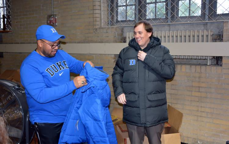 Michael Peace, left, and Patrick Killela check out the items they found at Friday's Duke Athletics Surplus Sale.