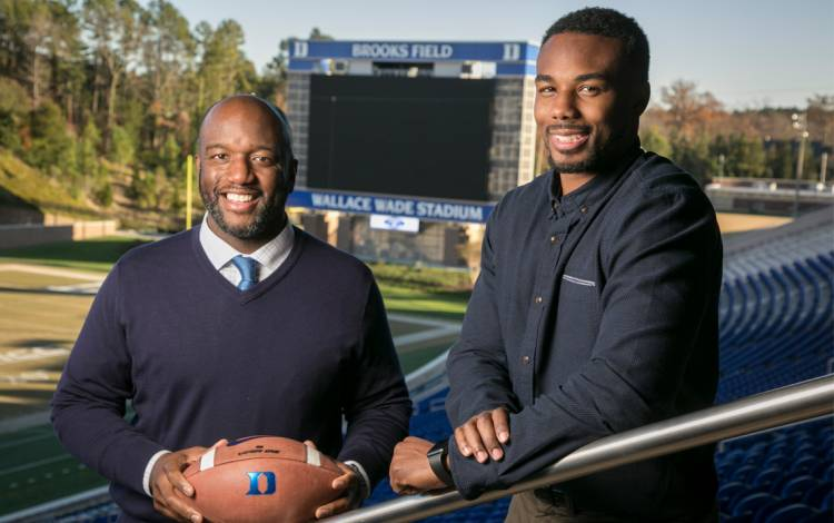Troy Austin, left, and DeVon Edwards, right, have gone from leading Duke on the football field to supporting the Blue Devils through positions in athletics administration.