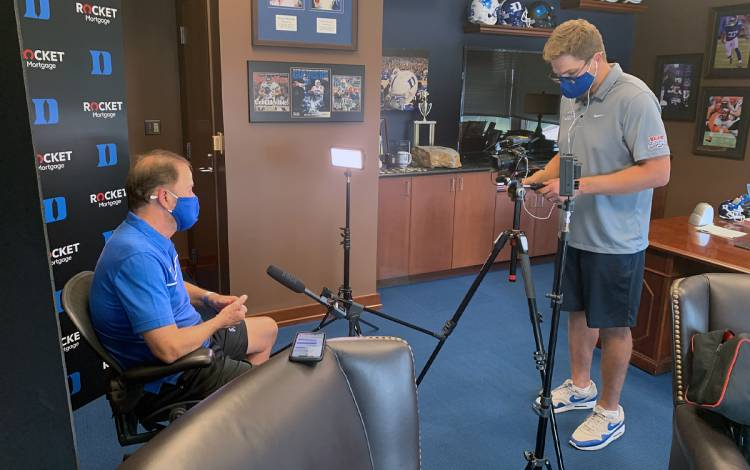 Blue Devil Network Executive Director Dave Harding records an interview with Duke Football Coach David Cutcliffe. Photo courtesy of Blue Devil Network.