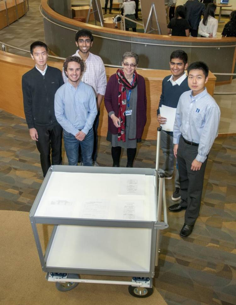 Rubenstein Research Services Archivist Trudi Abel (center) with members of the All-Terrain Manuscript Team (left to right): Joey Zhou, Kevin Kerner, Aneesh Gupta, Vineet Alaparthi, and Keyu Han.