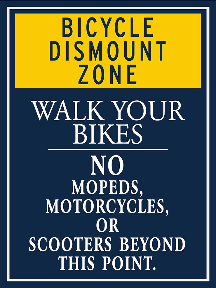 Signage for Bicycle dismount zone on West Campus.