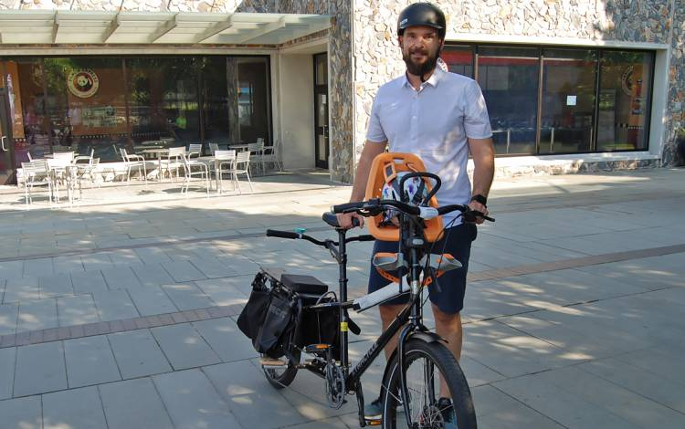 Biomedical engineering scientist David Bradway shows off his bike during Friday's Bicyclist Appreciation Breakfast.