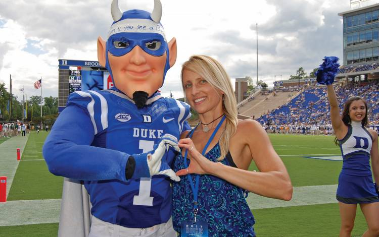 If you see the Duke Blue Devil mascot at a sporting event, odds are Duke cheerleading coach Alayne Rusnak, above, is nearby.