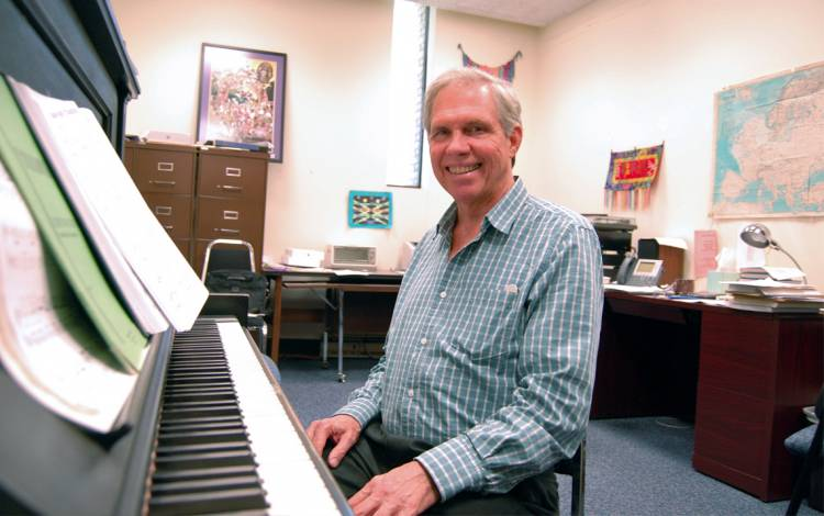 Tom Brothers sits in his office in the Biddle Music Building. The office used to belong to ground-breaking jazz talent Mary Lou Williams. Photo by Stephen Schramm.