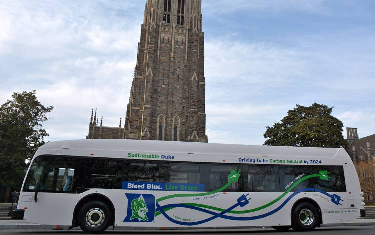 One of the electric buses displays the Sustainable Duke logo.