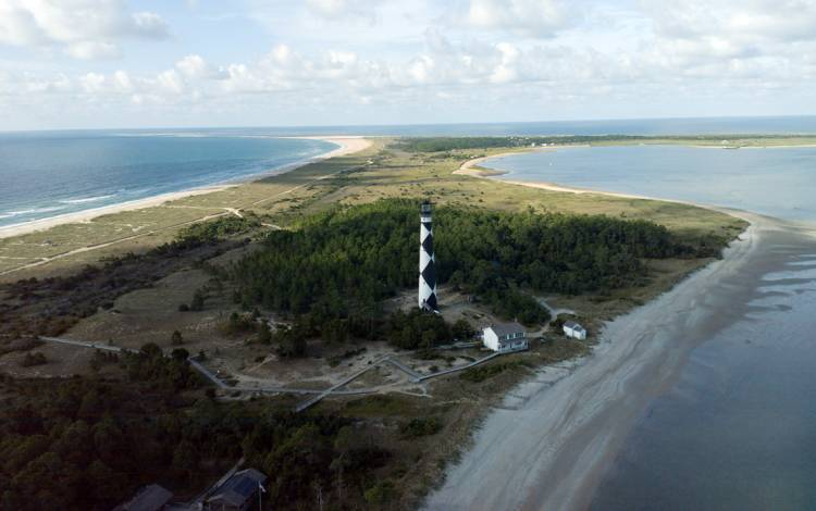 A view from a drone of Cape Lookout National Seashore with Cape Lookout Lighthouse in 2016. Photo taken during permitted research and courtesy of Duke Marine Robotics & Remote Sensing Lab.