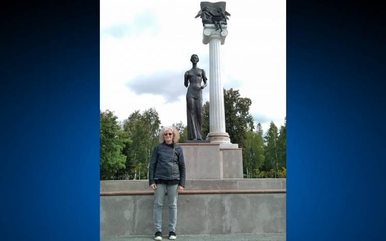 Carol Apollonio poses in front of a statue in Tomsk, Russia. Photo courtesy of Carol Apollonio.