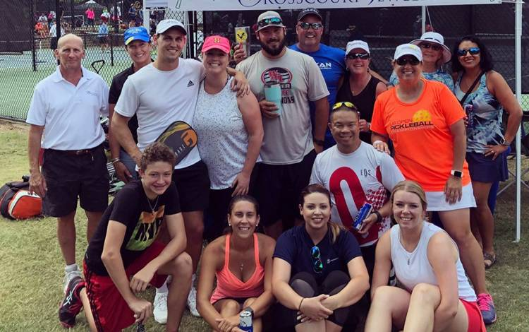 Clifford Chu, kneeling, second from right, poses with his teammates after a pickleball tournament. Submitted photo.