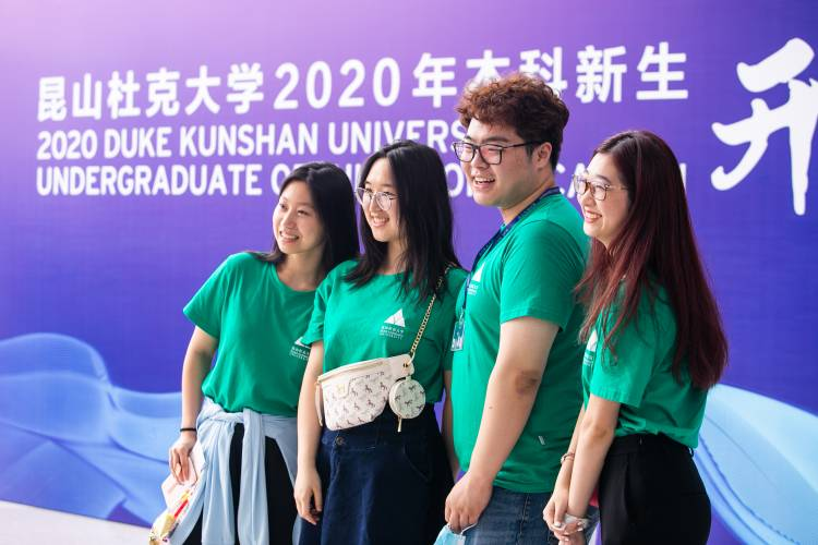 Students posing for pictures at DKU Convocation.