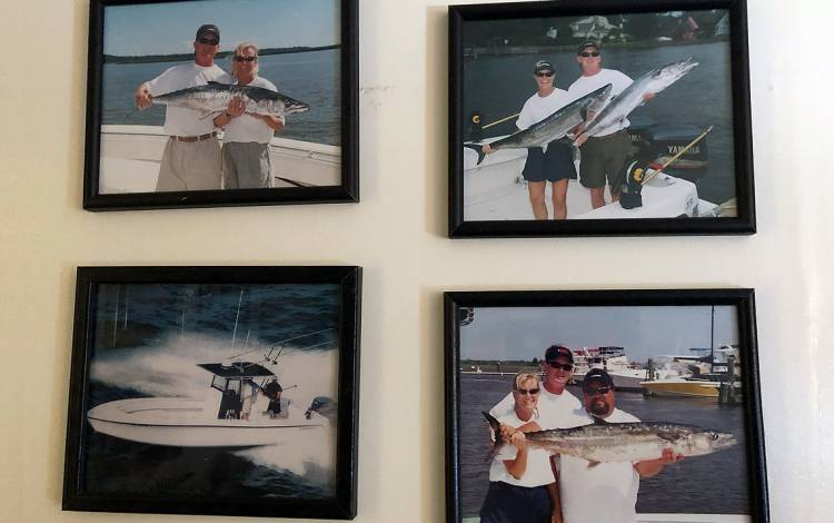 Fishing tournament photos of Dot Mishoe hang in her campus office. Photo by Leanora Minai.