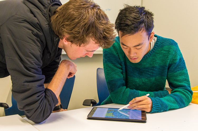 Walker Grimshaw (left) and Shawn Li refine the service boundaries for one local drinking water system in North Carolina. Students worked in pairs during the mapping process to learn from each other and provide added accountability.