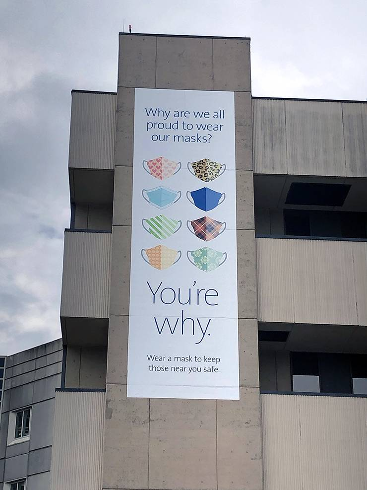 A banner urging the community to wear a mask hangs from Duke University Hospital. Photo courtesy of Duke Health Marketing & Communications.