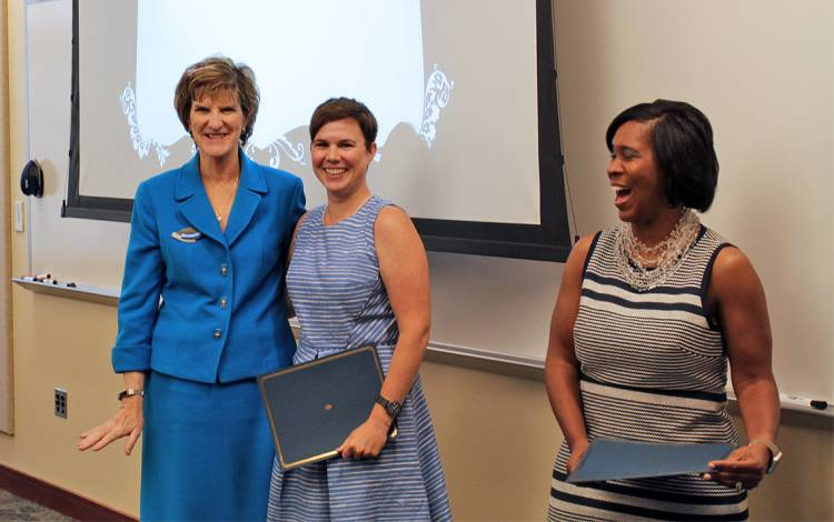 Libby Joyce, center, is greeted by Marion Broome, Dean of the School of Nursing, left, and Duke Learning and Organization Development Director Keisha Williams, right.