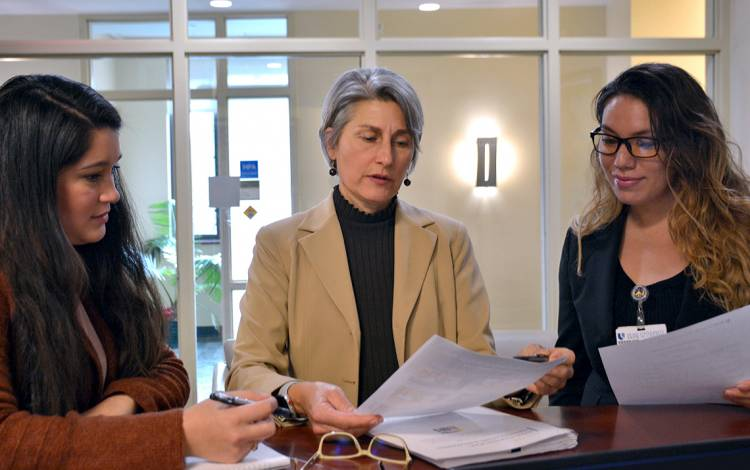 Diane Uzarski, center, meets with colleagues at the Duke University School of Nursing. Photo by Jonathan Black.