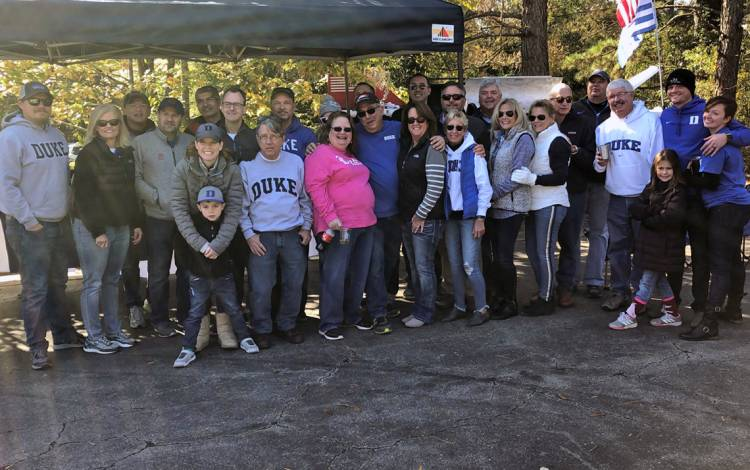 Donna Flamion, second from left, often organizes tailgate parties for Duke football games that draw dozens of guests. Photo courtesy of Donna Flamion.